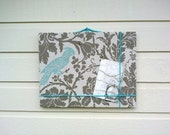 Linen Pin Board, taupe and turquoise botanical print with a parrot image and accented with jute twine, dorm or office decor