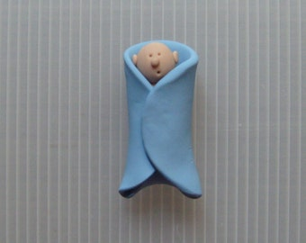 polymer clay baby boy in a blanket magnet