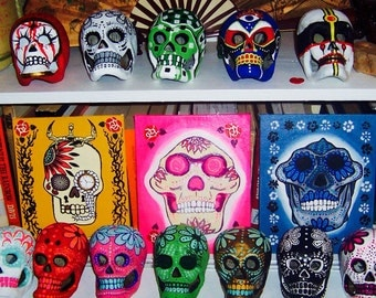 1 Original Painting canvas painting and 1 Dia de los Muertos (Day of the Dead) paper mache skulls.