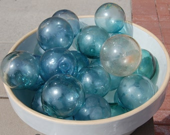 Antique, hand blown Japanese fishing net float balls. Guaranteed old, varying colors, these have rough pontils on them. Over 20 available.