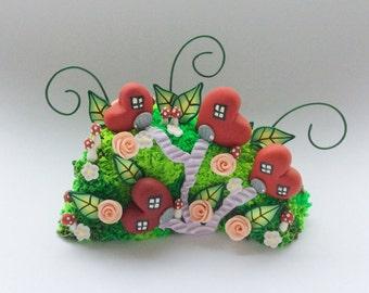 Miniature fairy heart village sculpture handmade from polymer clay