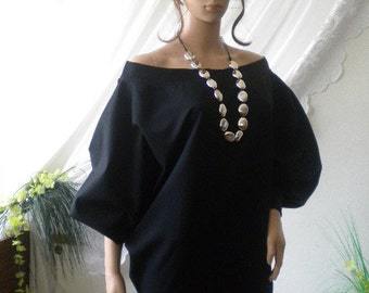 Women in black tunic -poncho