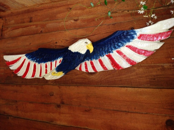Flying americana bald eagle ft red white blue chainsaw carved