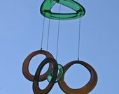 green and brown glass wind chime mobile from recycled bottles