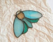 Sky blue, beige and green moth stained glass