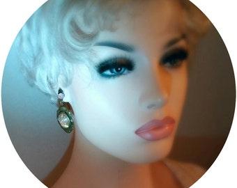 Vintage pierced earrings - drop of oval large aurora borealis Swarovski rhinestone in a Brass ornate setting - pink little flower bud at top