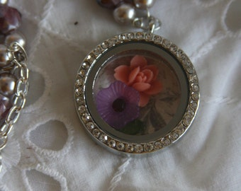 floating charm necklace glass covered flowers leaf pink purple round pendant silver objects move around inside pendant purple beads