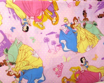 Disney Princesses on Pink Dots cotton fabric by Springs Creative Fabric