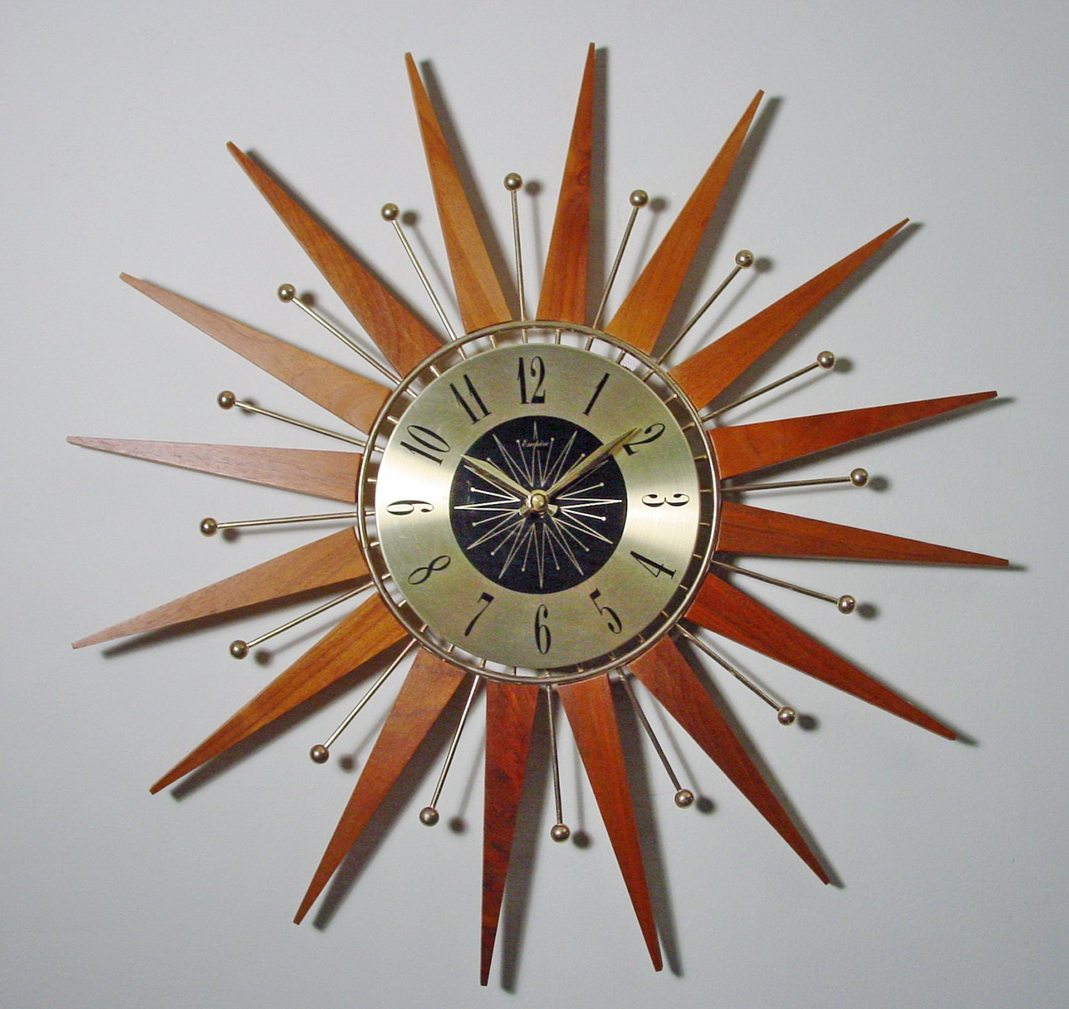 mid century modern starburst wall clock teak and by clubmoderne. Black Bedroom Furniture Sets. Home Design Ideas