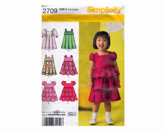 Little Girls Toddler Dress with pleated or tiered skirt Sewing Pattern UNCUT OOP Sizes 1/2 1 2 3 4 Simplicity 2709 Puff sleeeves sleeveless
