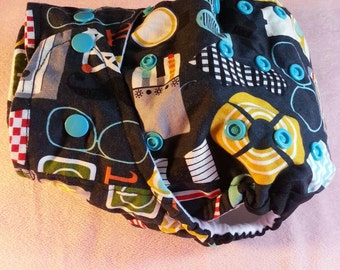 SassyCloth one size pocket diaper with geeky cotton print. Ready to ship.