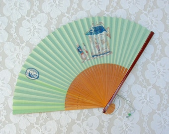 Chinese Paper Fan, one side - green, other side - white, illustrated