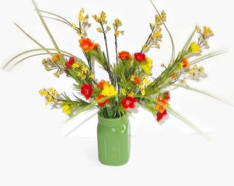 Mini Poppies in Yellow, Orange And Red With Yellow Sprigs In A Green Mason Jar Vase