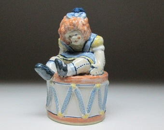louisville stoneware raggedy ann type doll dated 1983 , a heavy christmas ornament