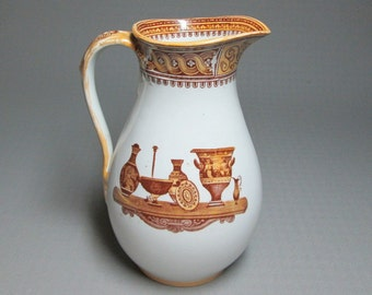 brown transfer pitcher with greek urns marked on the bottom 3048 / 31