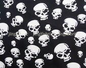 C130A - 1 meter Cotton Satin Fabric - Skulls on black background (145cm width)