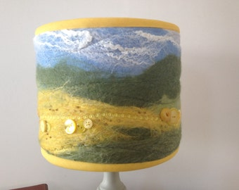 Handcrafted wet felted lampshade depicting country landscape of rape or sunflower fields