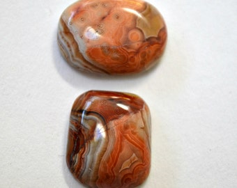 2 orange lace agate cabochons 15.8 x 13.3 and 17.5 x 13.7 x 5.2