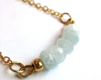 Delicate necklace in gold with aquamarine beads, gold filled chain
