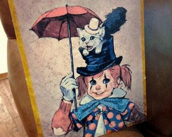 Vintage art work of clown girl and kitten