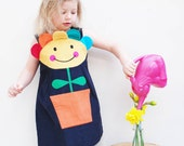 Flower pot girls dress with smiley face.