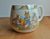 Bunnykins Royal Doulton Dome Cup Playing with Dolls.