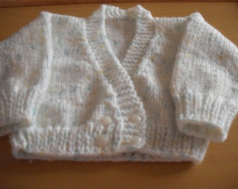 hand knitted baby cardigan 0-3 months in Wendy Bambino DK wool in white, green, yellow fleck