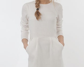 dress with pleats and pockets in cream