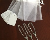 """50 wedding favors  or baptism favors 50 pcs Organza bags, 4"""" x 6"""" white organza bag ,50 white  mini  rosaries  favor and 50 white tags ,"""