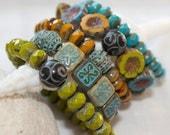 stackable bracelets . turquoise, pumpkin, carved flowers, olive, brass . 1 bracelet