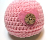 Newborn baby girl pink crochet hat with heart and button.  Pregnancy reveal for it's a girl photography prop for newborn girl.