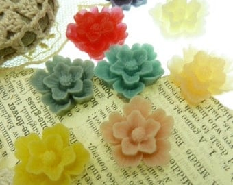 10  peony resin cabochons in a mix of colors. Size  28 mm x 6 mm