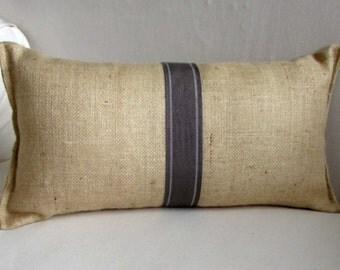blonde burlap lumbar pillow with decorative tape in elephant