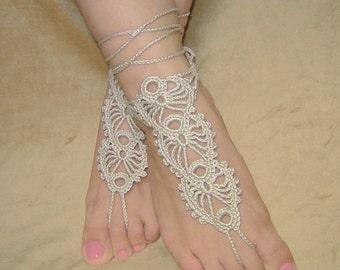 Light beige crochet barefoot sandals.
