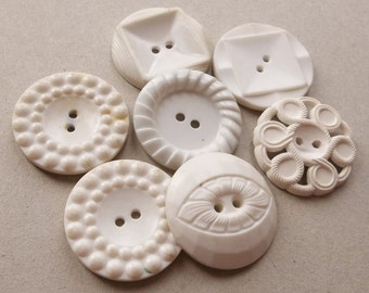 large white and off white large vintage eco friendly celluloid and plastic buttons--mixed lot of 7