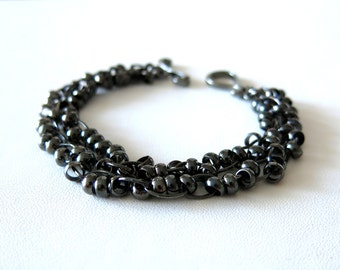 Gun metal 2-strand bracelet finished with toggle clasp.