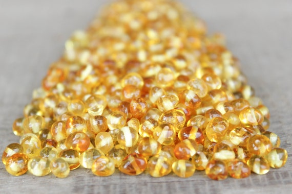 50 pcs Yellow Baltic amber beads with hole.