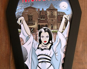 Lily Munster coffin framed print.