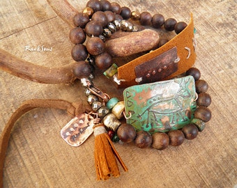 """Tribal Bracelet, ethnic """"Caveman"""" primitive Symbol engraved on patinated copper, tan leather, pyrite, sandalwood, turquoise and shell"""