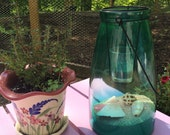 Hanging lantern with candle and beach theme