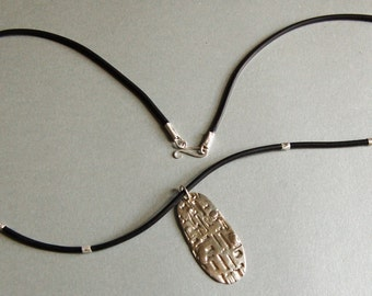 Sterling silver Maya pendant.