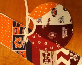 A house decided...Auburn and Mississippi State Burp Cloth and bib.