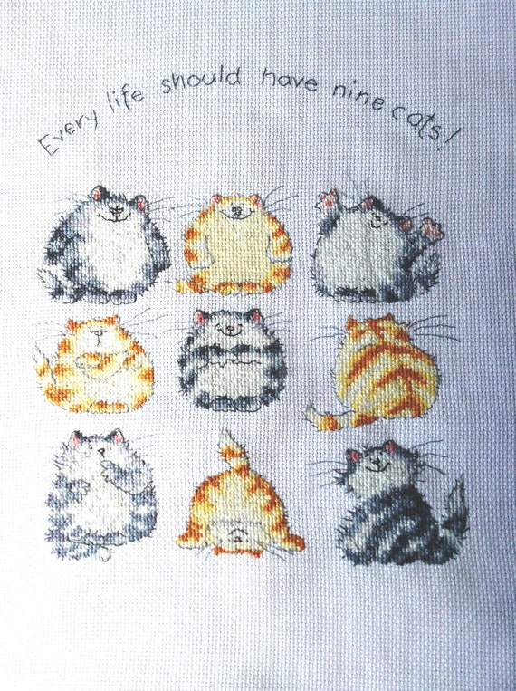 Every Life Should Have Nine Cats - a cross stitch picture.
