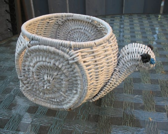 Staircase in white rattan. Planter.
