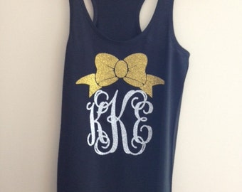Tank with bow and monogram