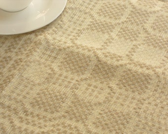 Hand woven linen table runner natural oatmeal pale yellow square geometric traditional huckaback pattern