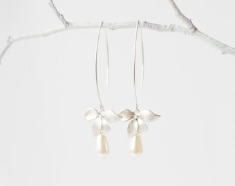 Delicate silver orchid flower earrings with pearl