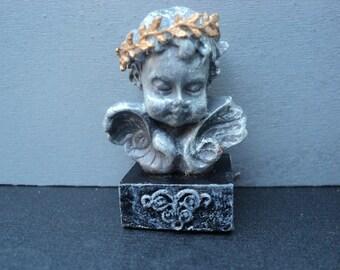 Miniature statue  cherub bust with laurel crown