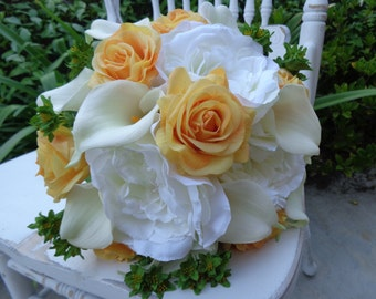 Bridal bouquet in real touch roses,calla lilies and open garden roses