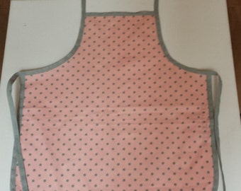 Child's cotton apron in pink & grey polka dot fabric